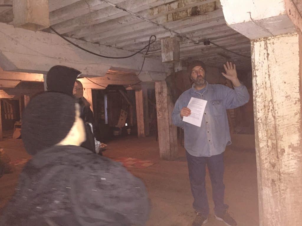 Tour guide describing beams