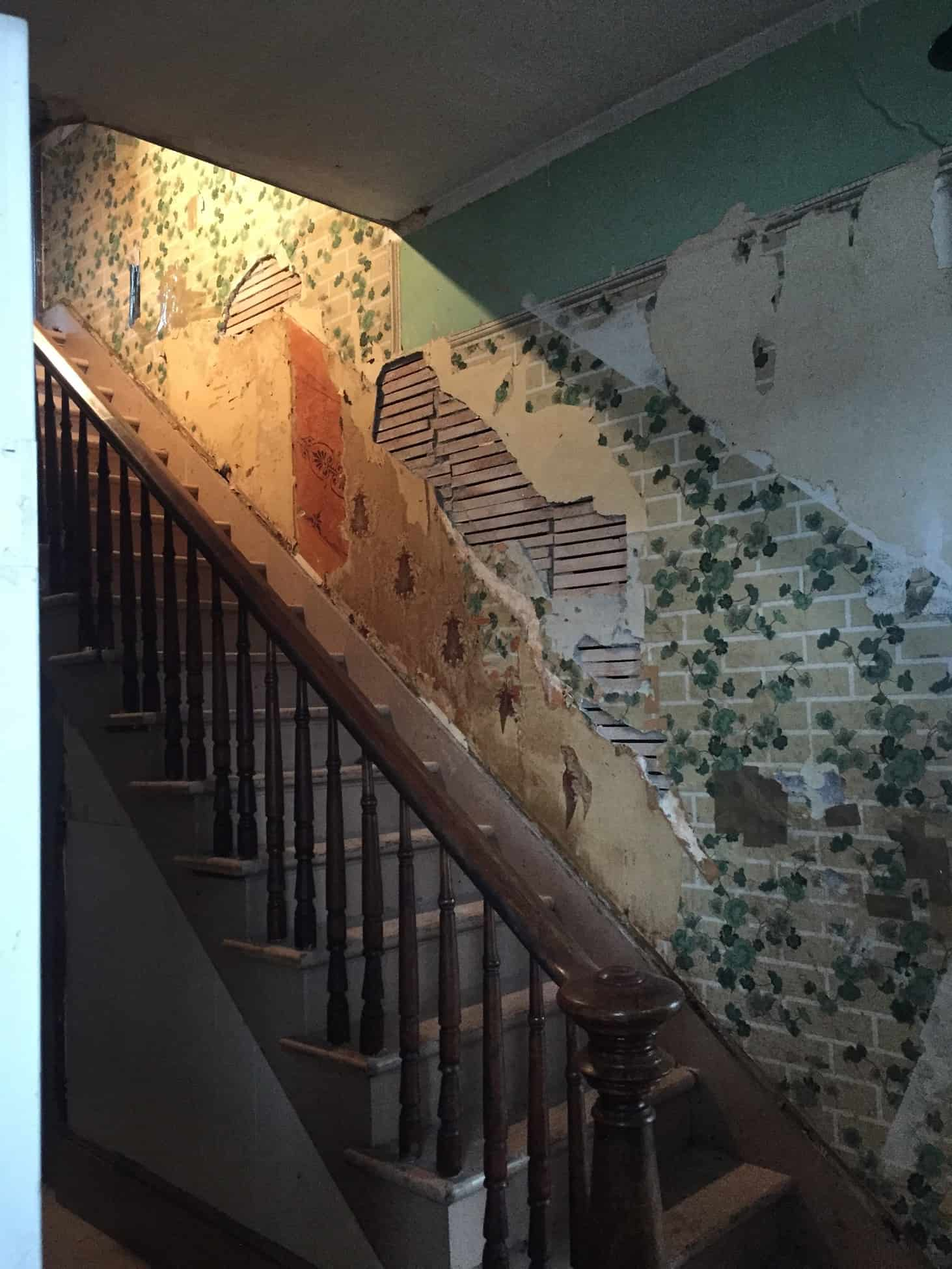 Layers of wallpaper and plaster at the Donaca House.